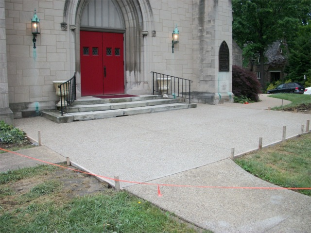 Repaired sidewalk at front entrance