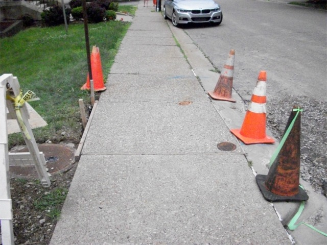 Repaired sidewalk along Mayfair Drive