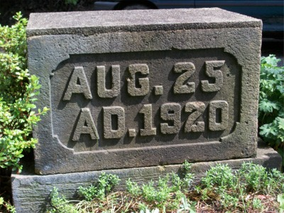 Building date on stone on lawn